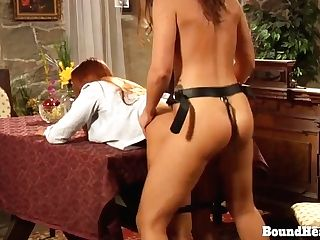 Horny Lezzie Madame Takes Big Strap-on From Behind By Gimp